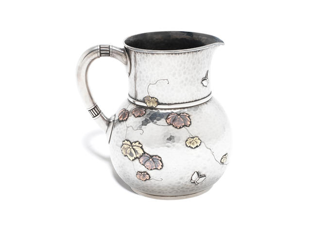 """A late-19th century American silver and mixed metalware pitcher by Tiffany & Co. 1875 - 1891, pattern number """"4706"""" order number """"9593"""""""