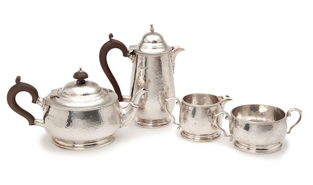 4 piece silver tea service wth hammered finish by Adie Bros., Birmingham 1921/24