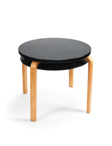 Alvar Aalto for Finmar Ltd Table 70 designed 1933  applied plaque for Finmar Ltd birch faced moulded plywood with lacquered tops  Height: 56.5 cm.                22 1/4 in. Diameter: 62.5 cm.                  24 5/8 in.
