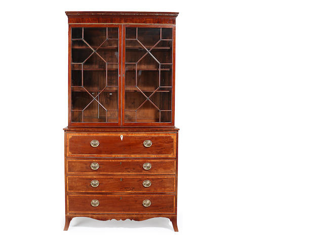A George III mahogany and satinwood crossbanded secretaire bookcase