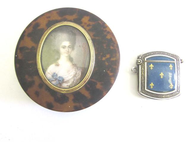 An 18th century French School portrait miniature of a lady holding a cello circa 1770; together with an early/mid-20th century German silver and enamel vesta  (3)