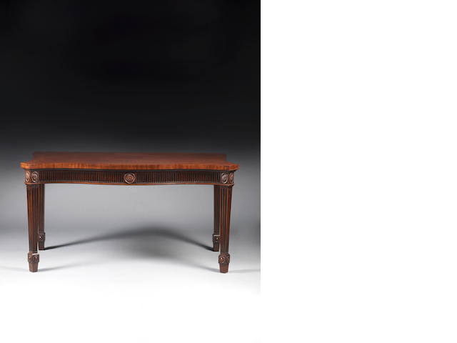 A George III mahogany serpentine serving table