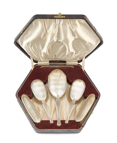 A csased six piece 9 carat gold backed dressing table set by W Neale & Sons Ltd, Birmingham 1929