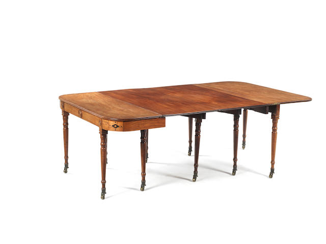 A Regency mahogany patent concertina action folding dining table by Thomas and William Wilkinson of Moorfieldswith two additional leaves