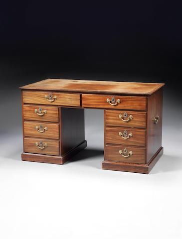 A George III mahogany pedestal desk