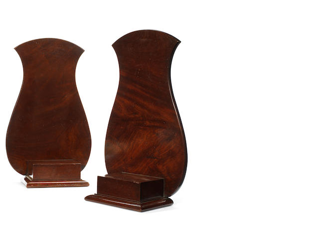A pair of early 19th century mahogany charger stands