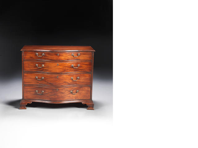 A George III mahogany serpentine chest