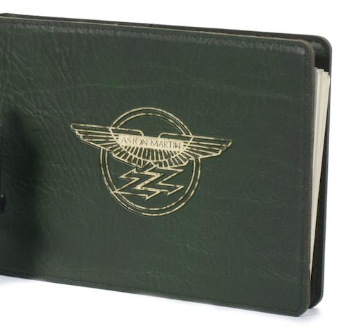 An Aston Martin Vantage Zagato owner's handbook, signed by Victor Gauntlett,