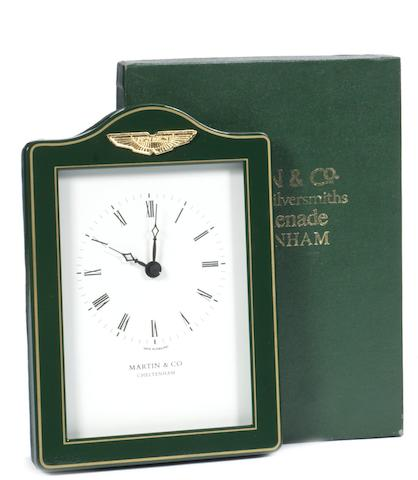 An Aston Martin desktop clock by Martin & Co of Cheltenham,
