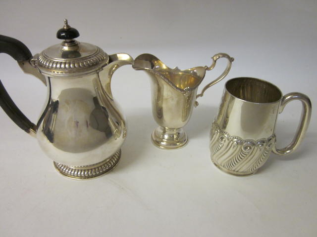 A silver baluster shaped jug, by Richard Woodman Burbridge (chairman of Harrods) London 1931, retailers marks for Harrods  (3)