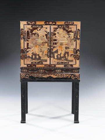 A late 18th/early 19th century Chinese coromandel lacquer and bronze mounted cabinet on a later stand