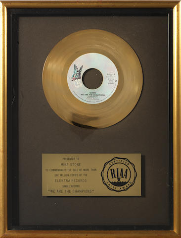 Queen: An RIAA gold award for the single 'We Are The Champions', January 1978, presented to Mike Stone,