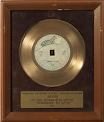 Queen: Two Japanese in-house awards for the singles 'You're My Best Friend' and 'Somebody To Love', 1977, presented to Mike Stone,