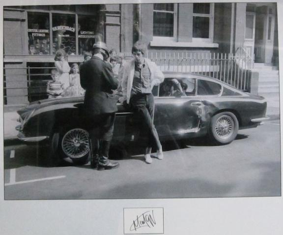 A photograph of Mick Jagger and his Aston Martin DB6, taken 25th August 1966,