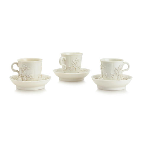 Three St. Cloud white coffee cups and trembleuse saucers Circa 1725