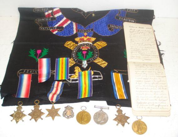 A 1st World War medal group, to 7591 Sjt. A Sinclair Cam'n Highrs., War medal, 1914-15 Star and Victory medal, and to his brother 7937 L-Cpl H Sinclair Cam'n Highrs., 1914-15 Star & Victory medal, mostly with original boxes, and to their cousin 7631 Pte. A Russell Cam'n Highrs., 1914 'Mons' Star and a 1st QO. Cameron Highlrs. silver medal, inscribed to 'Pte A Russell D. Coy Winners 1st Guards Bde and 1st Division Bayonet Fighting Competitions Aldershot 1912, and his hand written winter training note book commencing 4.1.09, a France & Germany Star, various buttons and a 2nd Bn The Queen's Own Cameron Highlanders Sampler with battle honours.