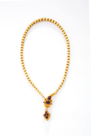 A late Victorian gold and garnet memorial serpent necklace,