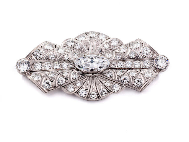 An unmounted marquise-cut diamond weighing 4.18 carats