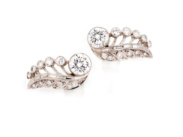 A pair of diamond earclips,