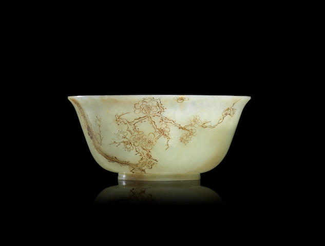 A gilt-decorated white jade bowl Early Qing dynasty