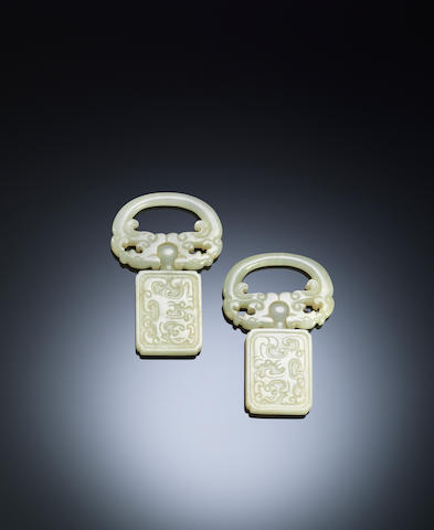 A pair of white jade belt slides  Mid Qing dynasty