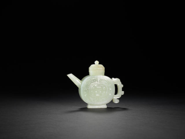 An archaistic white jade ewer and cover Qianlong