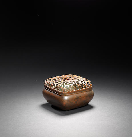A copper hand warmer with pierced cover Late Ming dynasty