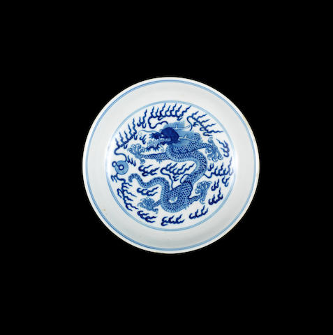 A blue and white 'dragon' dish Qianlong seal mark and of the period