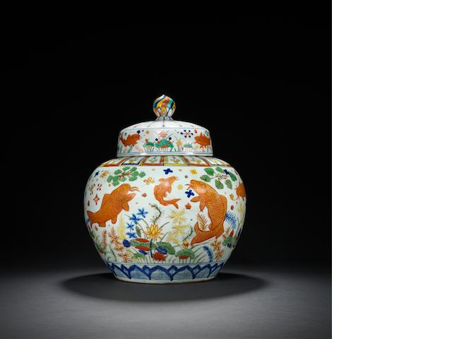 A magnificent and brilliantly enamelled wucai 'fish' jar Jiajing six-character mark and of the period
