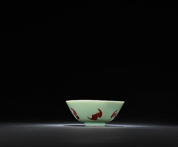 A fine celadon-glazed and copper-red decorated 'wufu' bowl Yongzheng six-character mark and of the period