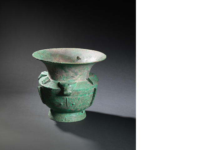 An exceptional large archaic bronze ritual wine vessel, zun  Shang dynasty