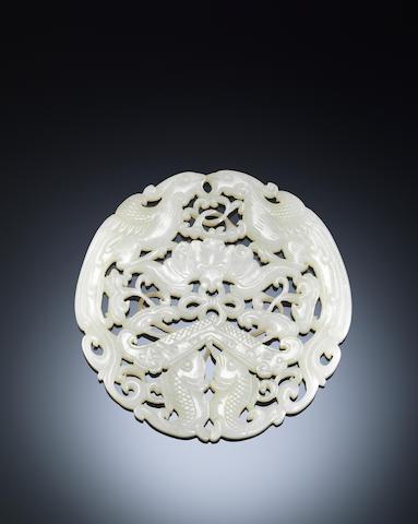 A white jade 'auspicious' circular plaque Qianlong