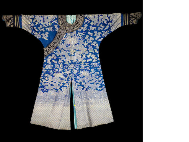 An embroidered blue-ground 'dragon' silk robe Qing dynasty