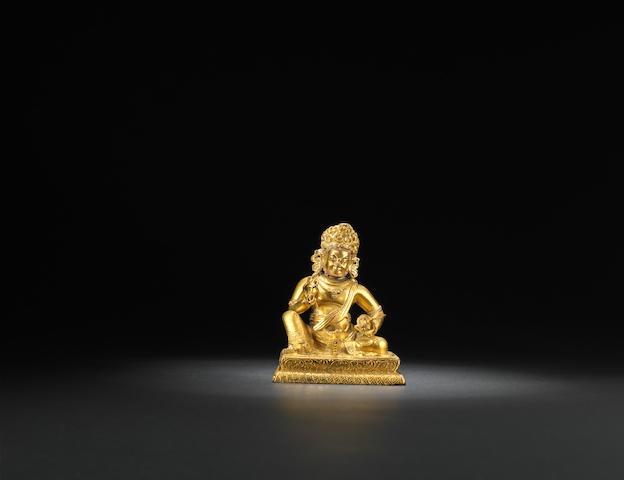 A Tibetan-inscribed gilt-bronze figure of Jambhala Mid Qing dynasty