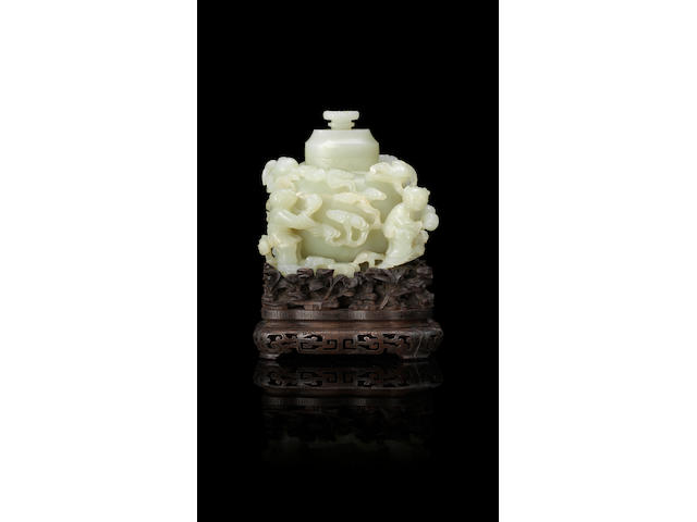 An exceptional Imperial white jade 'Dragon and Hehe Erxian' vase and cover  Qianlong