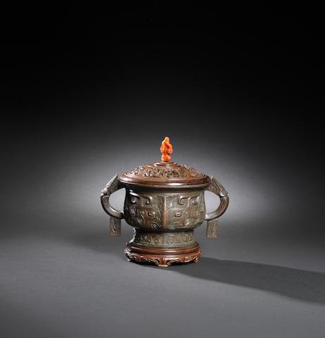A bronze archaistic incense burner Qianlong