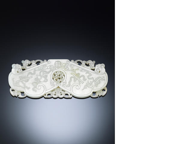 A rare white jade ruyi-shaped 'auspicious objects' plaque Qianlong