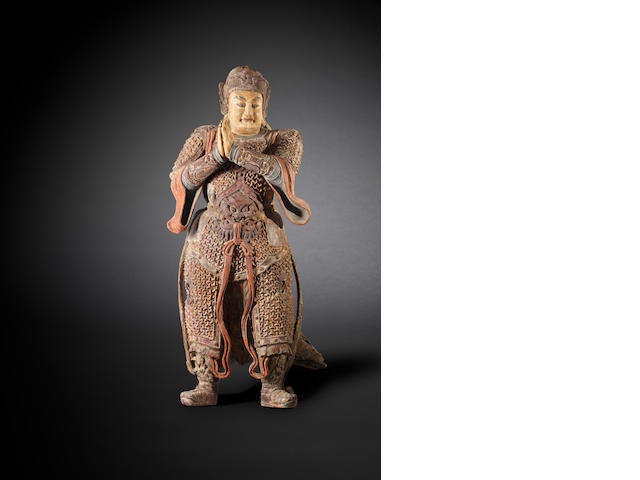 A monumental and extremely rare polychrome wood figure of a Guardian, Weituo Wanli
