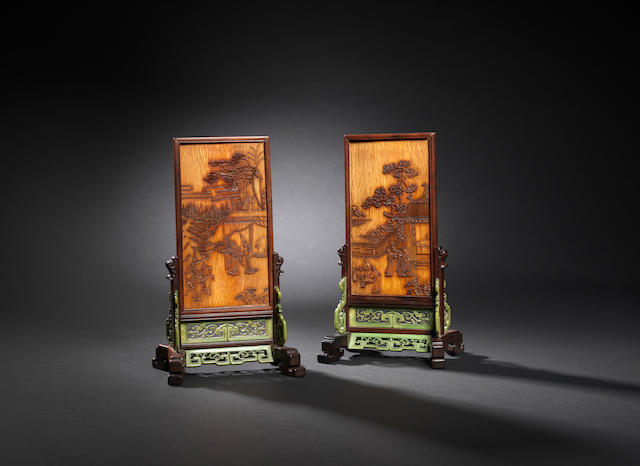 A pair of stained ivory screens and stands Mid Qing dynasty