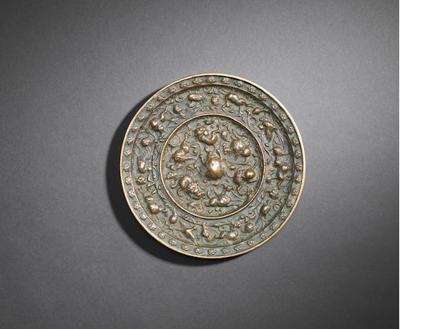 A large bronze 'lions and grapes' mirror Liao dynasty