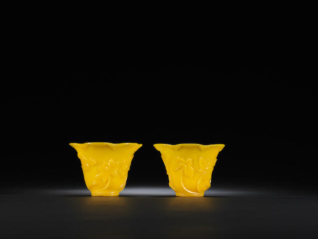 A pair of yellow glass 'lotus' cups Mid Qing dynasty