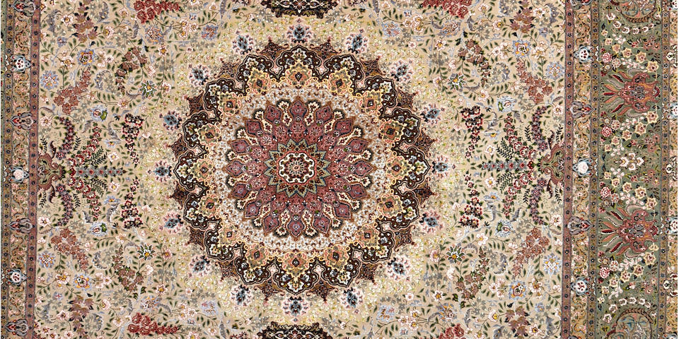 A large Tabriz carpet, North West Persia, 494cm x 350cm