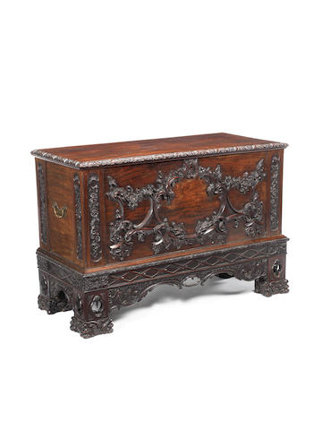 An Irish rococo style carved mahogany clothes chest based on a design by Thomas Chippendale