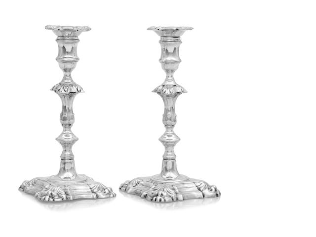 A pair of George II silver candlesticks by John Cafe, London 1753/54