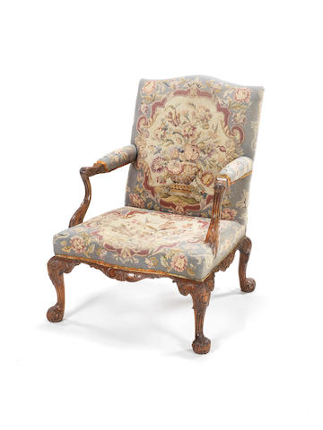 A George II carved mahogany library armchair in the manner of Paul Saunders