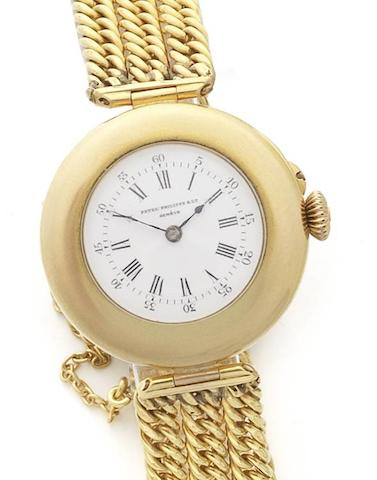 Patek Philippe. A rare and very early 18ct gold manual wind bracelet watch with Extract from Archives  Case No.201786, Movement No.84612, Manufactured 1889, Sold 6th January 1890