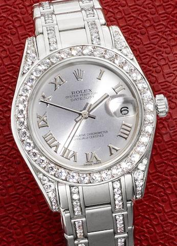Rolex. A mid-sized 18ct white gold and diamond set automatic calendar bracelet watch together with Rolex box and papersPearlmaster, Ref:81209, Case No.P783***, Circa 2000