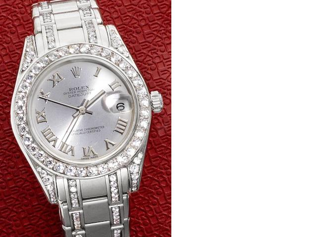 Rolex. A mid-sized 18ct white gold and diamond set automatic calendar bracelet watch together with Rolex box and papers Pearlmaster, Ref:81209, Case No.P783***, Circa 2000