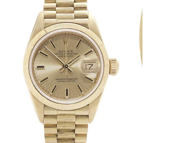 Rolex. A lady's 18ct gold automatic calendar bracelet watch with papers Datejust, Ref:69278, Serial No.869****, Sold 2nd November 1985