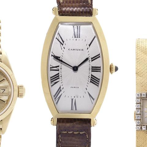 Cartier. An 18ct gold manual wind tonneau shaped wristwatch Circa 1990